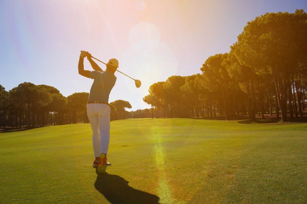 golf player shot ball
