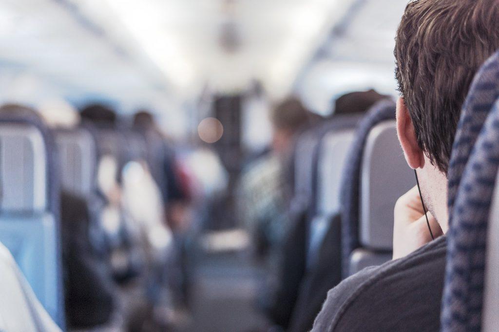 man sitting on an airplane